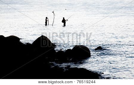 Fishing Spinning In The Sea. Silhouette Of A Fishermans