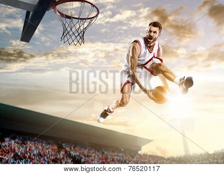 Basketball player in action on background of sky