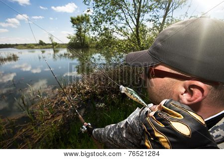 Angler is casting the top water lure