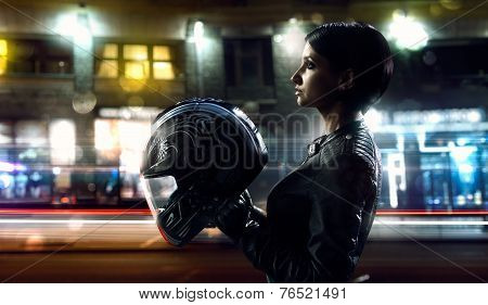 Biker woman on the night street