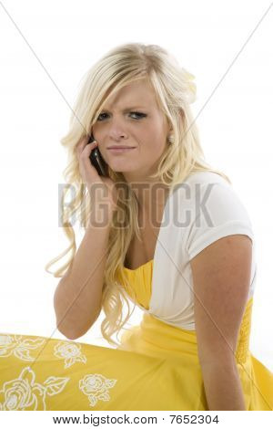Girl In Yellow Dress On Phone Frustrated