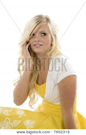 Girl In Yellow Dress On Phone Looking Up