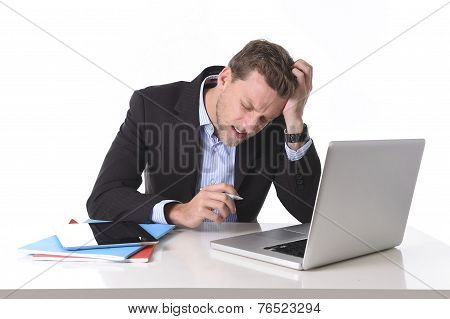 Attractive Businessman Working In Stress At Office Desk Computer Suffering Headache