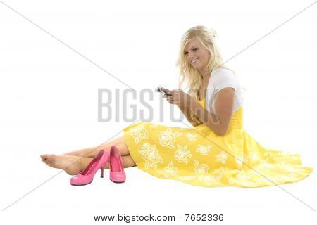 Girl In Yellow Dress Texting Pink Shoes
