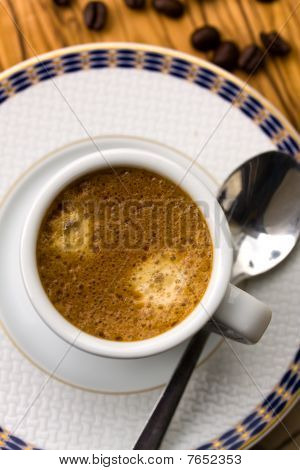 Cup of fresh Espresso with Coffee Beans