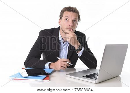 Businessman Working In Stress At Office Desk Computer Laptop Reflexive And Doubtful Pensive And Thou