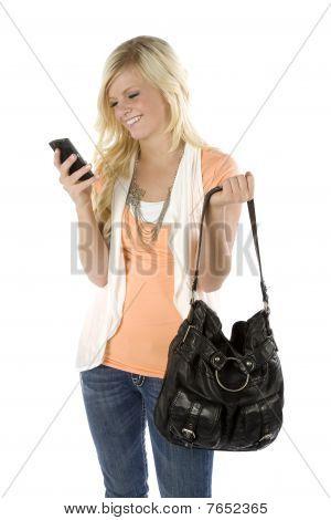 Girl Orange Shirt And Purse Texting
