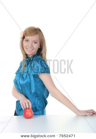 Young Smiling Girl Holding A Red Apple.