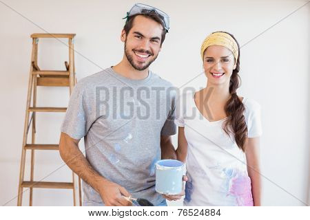 Cute couple redecorating living room in their new home