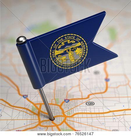 Nebraska Small Flag on a Map Background