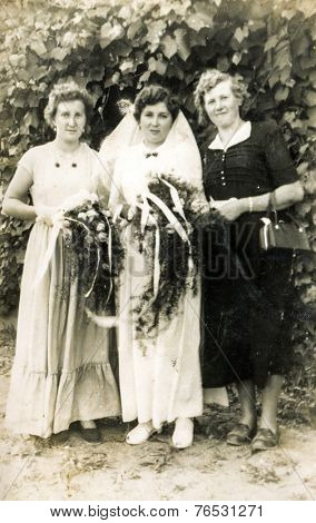 GERMANY, CIRCA THIRTIES: Vintage photo of bride with two women