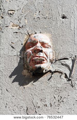 Face mask at a wall.