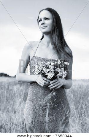 Girl Walking On The Field