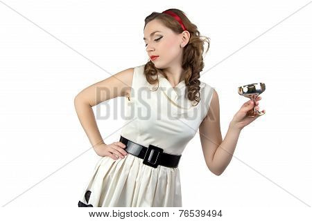 Photo of woman looking down with metal snifter
