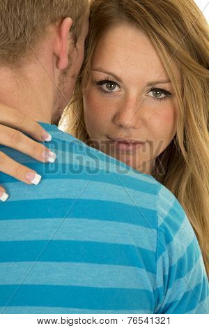 Woman Looking Close Over Mans Shoulder Serious