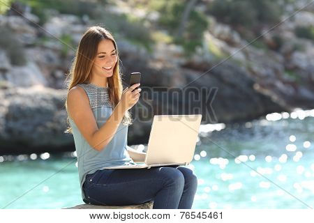 Entrepreneur Woman Working With A Phone And A Laptop
