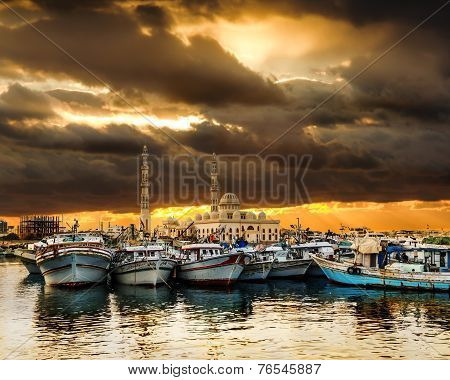 Fishing Boats At The Port Of Hurghada, Hurghada Marina At Sunset Against The Mosque