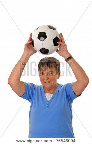 Senior Woman Throwing A Ball