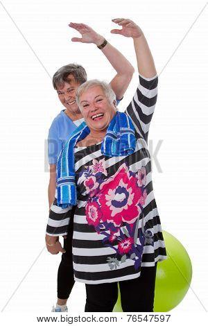 Two Senior Women Doing Gym Exercises