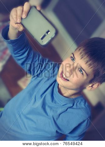 boy taking selfie with mobile phone