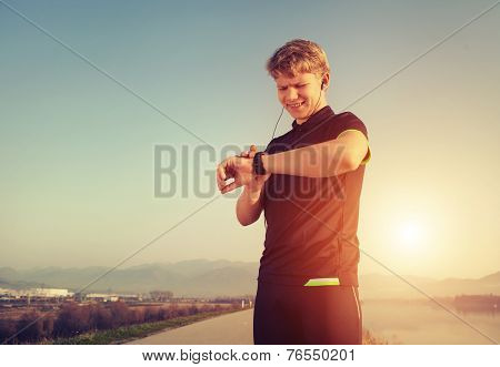 Runner Starts His Modern Stopwatch Before Jogging