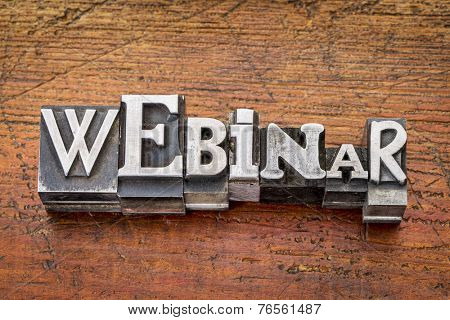 webinar word in vintage metal type printing blocks over grunge wood, mixed fonts in style and size