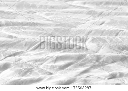 Soft white sheets blankets on a bed