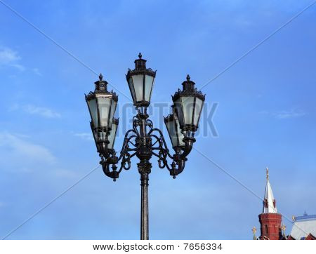 Lantern And Capstan On Sky Background