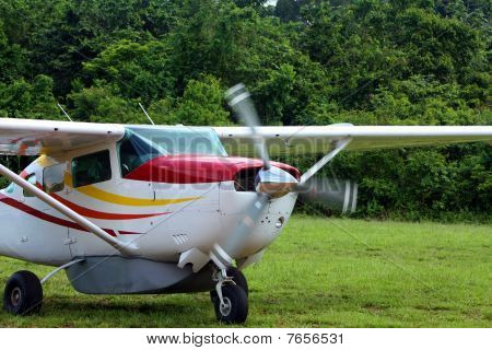 propeller airplane on soft  strip