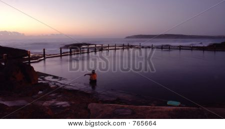 An early morning winter swim in an ocean pool