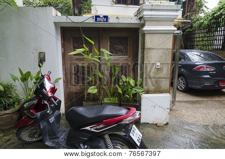 Phuket,TH-Sept,15 2014:Motorcycle near the doors with wooden pictures in Sept,15 2014 in Phuket,TH
