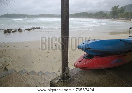 Surfboards and Kata Beach at stormy weather, Phuket, Thailand