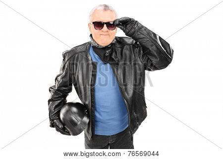 Cool mature motorcyclist holding a helmet isolated on white background