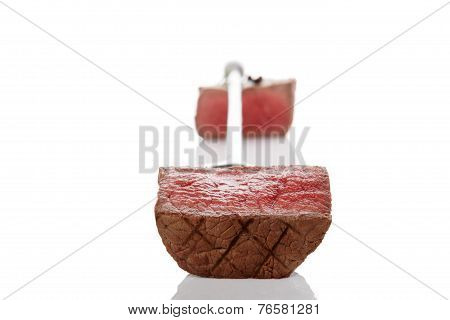 Steak Piece On Fork.
