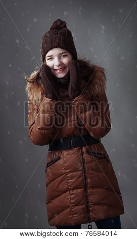 Beautiful Girl In Winter Clothes With Snow