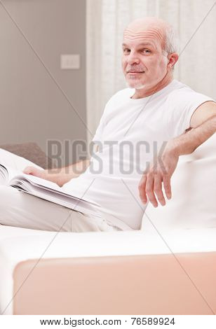 Sly Smile Of A Man Reading A Book