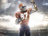 stock photo of football helmet  - American football sportsman player in open stadium - JPG