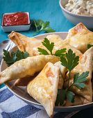 foto of samosa  - indian samosa filled with chicken curry on tray - JPG
