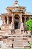 foto of hindu-god  - Ancient rock curved temples of Hindu Gods and godess at Mandor garden Jodhpur Rajasthan India - JPG
