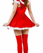 stock photo of red back  - Beautiful christmas woman wearing red santa claus dress and red stockings on sexy legs stay back on white background - JPG