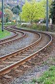 foto of tram  - Curved rusty tram rails  - JPG