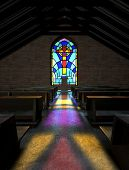 stock photo of crucifix  - A dim old church interior lit by suns rays penetrating through a colorful stained glass window in the pattern of a crucifix reflecting colours on the floor in amongst rows of church pews - JPG