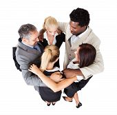pic of huddle  - High angle view of multiethnic business people forming huddle over white background - JPG