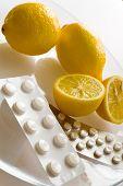 foto of home remedy  - fresh lemons and flu pills in blister - JPG
