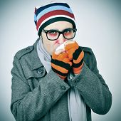 picture of snot  - a man with a cold bundled up in a coat - JPG
