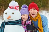 foto of snowmen  - funny dad and daughter with a snowman - JPG