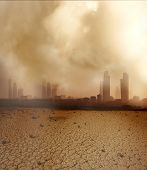 foto of global-warming  - Global Warming and pollution theme with cracked land and the cityscape - JPG