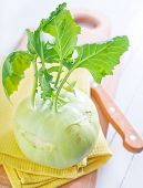 image of kohlrabi  - Cabbage kohlrabi on the Wooden Kitchen Board - JPG