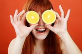 stock photo of redhead  - a redhead girl with an orange glasses - JPG