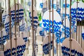 pic of windchime  - A blue and white wind chime with ocean or sea graphic - JPG